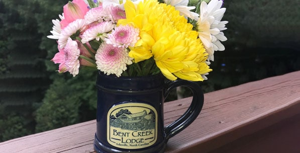 A floral bouqet in a keepsake mug